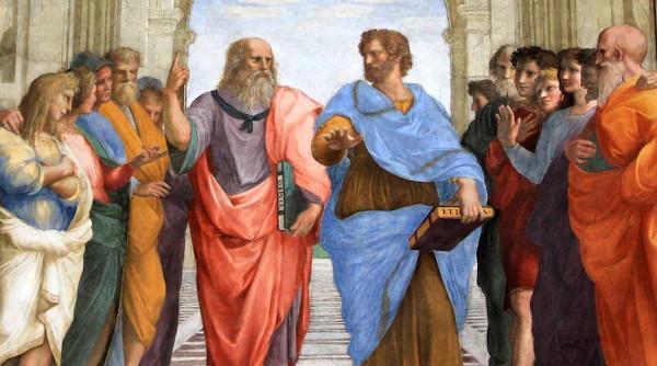 """O plano central do afresco Escola de Atenas apresenta Platão, o pai do idealismo, apontando para o """"mundo das ideias""""."""