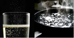 Qual a diferença entre as bolhas formadas com o aquecimento da água e as bolhas do refrigerante?