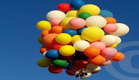 Como voar preso a balões