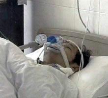Pessoa em estado de coma.