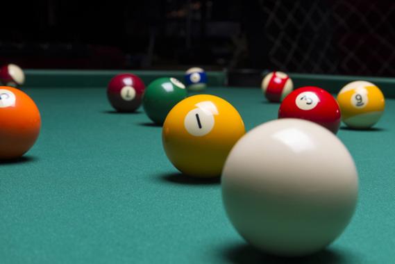 A bola de bilhar foi a inspiração para a formulação do modelo atômico de Dalton