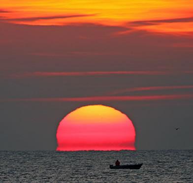 O avermelhado do Sol é devido a refração atmosférica